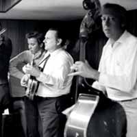 Tex Logan, Fred Bartenstein, Ralph Stanley, George Shuffler at Loy Beaver's basement, northern NJ. 1970 (photo: Artie Rose)