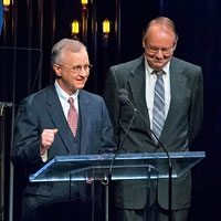 Fred Bartenstein and Gary Reid, co-authors of The Bluegrass Hall of Fame: Inductee Biographies 1991-2014, present Neil Rosenberg's Hall of Fame induction at IBMA Awards Show, World of Bluegrass, Raleigh, NC, October 2, 2014. (Photo: Daniel Boner)